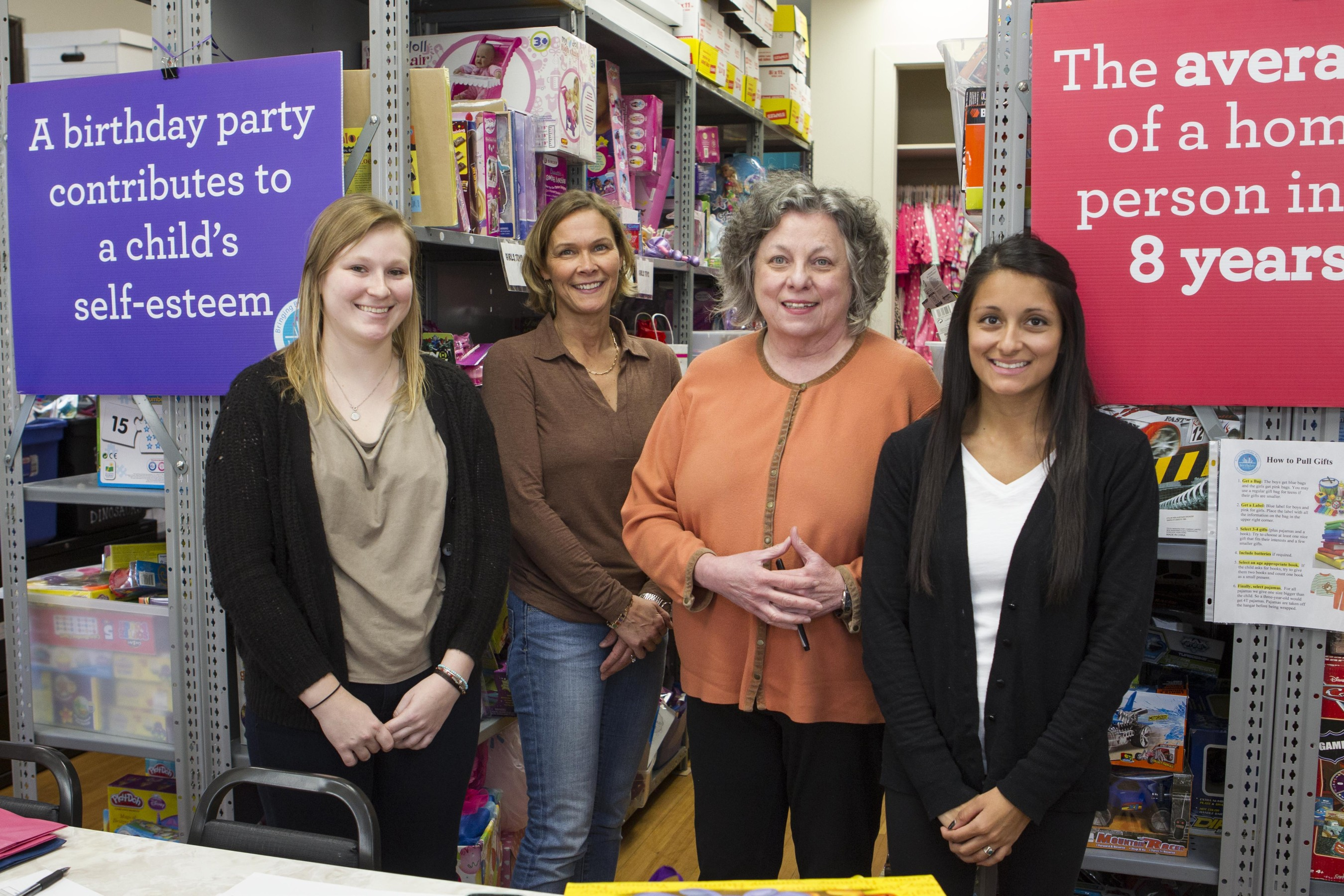 Heather Coen, intern, from left, Lisa Vasiloff, Cofounder & Executive Director, Susan Haviland, Associate Director, and Sarah Hennessy, Greater Boston Program Coordinator, pose for a picture at the Birthday Wishes' main office in Newton, Massachusetts on Wednesday November 18, 2015. Birthday Wishes is a NGO that organizes birthday parties for homeless children in Massachusetts, Rhode Island and Long Island, New York.